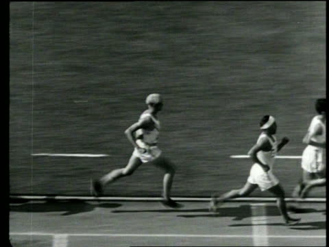 newsreel / no audio / view from the stands of runners running around a track in the summer olympics / runners making the turn and on the straight... - 1932 stock videos & royalty-free footage