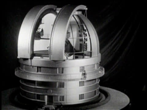 newsreel / no audio / warner and swasey company builds mirror for telescope / worker applies material using a brush to grind 82 inch mirror for... - inch stock videos & royalty-free footage