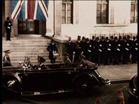 stockvideo's en b-roll-footage met newsreel / no audio / world war 2 / hitler pulling up to building in rolls royce / hitler greeting some officials outside the front of a building /... - 1938