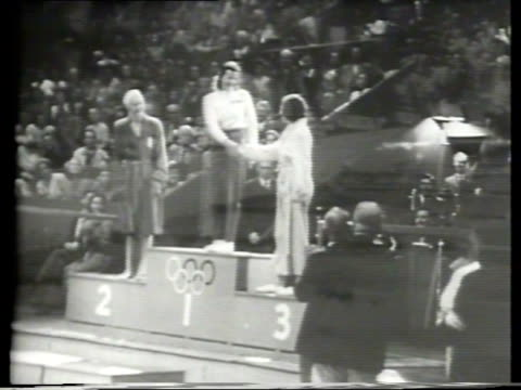 newsreel / olympic swimming / 100 meter women's freestyle event / they dive in / between american ann curtis and greta anderson of copenhagen /... - olympic medal stock videos & royalty-free footage