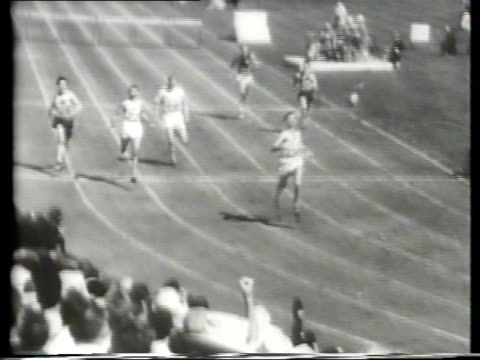 newsreel / olympic track and field / 400m hurdles / american roy cochran leads and wins gold he shatters the olympic record / women's 100m dash... - 一等賞点の映像素材/bロール