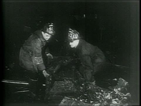 vídeos y material grabado en eventos de stock de newsreel / paramount news / fire at la salle hotel in chicago illinois kills 58 people in june 1946 / three burned chairs in hotel / two firefighters... - salida de incendios