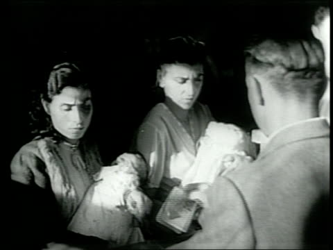 vídeos de stock, filmes e b-roll de newsreel / paramount news / king humbert exits power as italy has first democratic elections in 1946 / italian women vote for the first time for a... - 1946