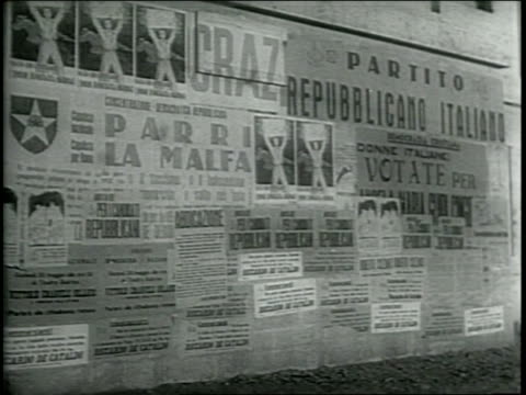 vídeos de stock, filmes e b-roll de newsreel / paramount news / millions of italians turn out as italy has first democratic elections in 1946 / streets packed with people / italians... - 1946