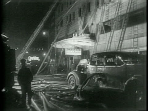 vídeos de stock, filmes e b-roll de newsreel / paramount news / title card reads chicago fire shocks nation 58 dead in hotel disaster / fire at la salle hotel in chicago illinois kills... - paramount building