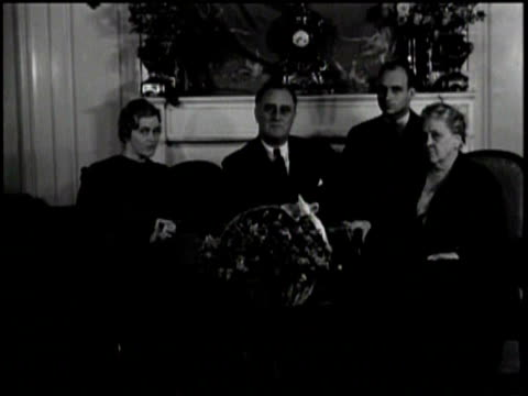 Newsreel / Pathe News / A title card that says President elect Roosevelt gives first message to the nation / A title card of an editor's note /...