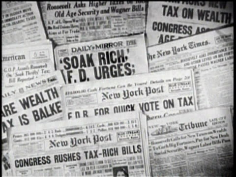vídeos de stock, filmes e b-roll de soak the rich / wall of newspaper headlines about economics / - primeira página de jornal