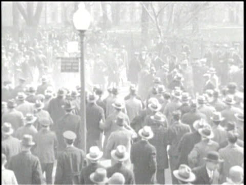 newsreel / pathe news / title card reads: tear gas bomb is set off by the police / jobless protesters are tear gassed in front of the white house in... - tear gas stock videos & royalty-free footage