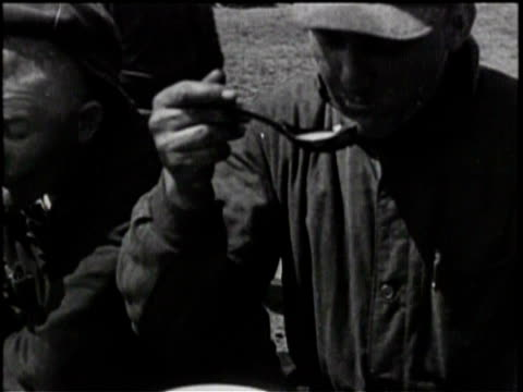 newsreel / peasant workers receive food from bread line / workers eating soup / tractors tend to fields / - peasant bread stock videos and b-roll footage