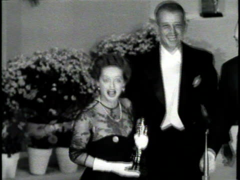 Newsreel / Poor Audio / Lauren Bacall accepts an Academy Award and says a few words to the audience / Lauren Bacall gets out of a taxi cab and walks...