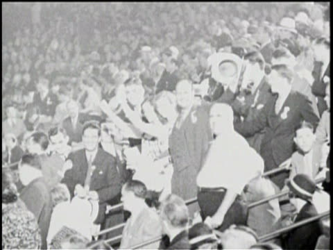 Newsreel / / Profile of the Next President Franklin Roosevelt / Various footage of FDR / At a pool with his family / At a convention a banner reading...