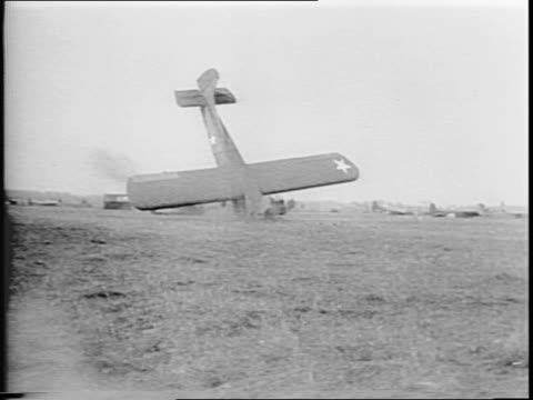 Newsreel / Sky troops led by gliders land in a field / One crashes /