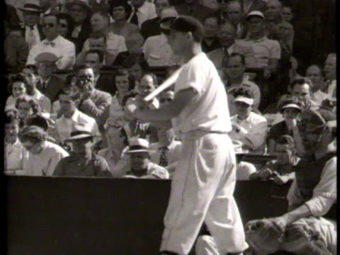 Newsreel / Some Audio / Slow motion of Jackie Robinson steals bases in game against Chicago White Sox / Jackie Robinson fielding a ball / Umpire...