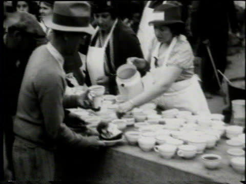 newsreel / thousands of people left homeless by earthquake gather in long beach park receive food from charitable organizations / people in line for... - charity and relief work stock videos & royalty-free footage