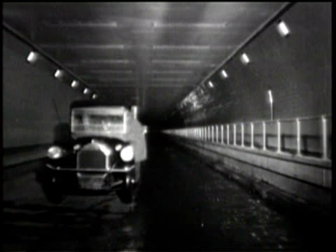 newsreel / workers build twomile tunnel under hudson river in new york / workers riding rail cars with dirt removed from tunnel outside of tunnel /... - lappen reinigungsgeräte stock-videos und b-roll-filmmaterial