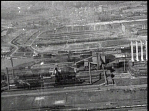 Newsreel / Workers Leaving The Factory / Graph Shows Example of Income Split / Aerial Shot Of Factory /
