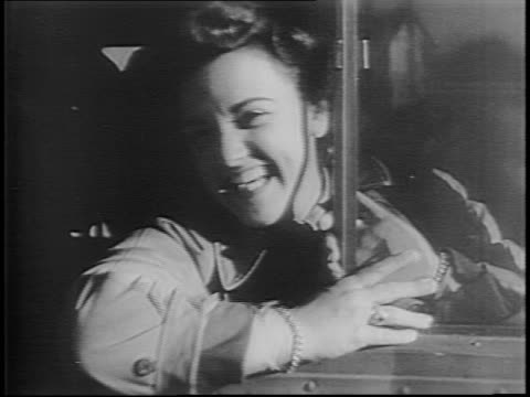 Newsreel / WWII / Women's Army Corps WAC reach Sydney Australia / WACS exiting ship / Hazel Miller greeted by General / Soldiers whistle at WACS /