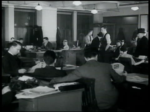 newsroom w/ reporters at desks editor amp circulation manager waiting at desks smoking two men standing 'ready' at teletype machines - new york daily news stock videos and b-roll footage