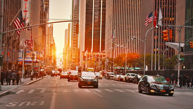 newyork avenue. street. traffic. american flag. city. - yellow taxi stock videos & royalty-free footage