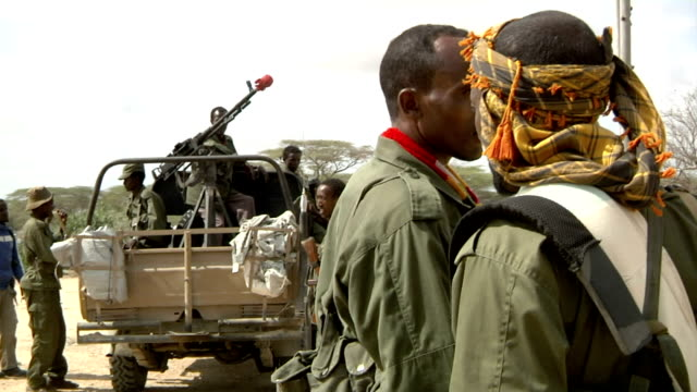 next to a pickup truck Somali militia men on July 31 2011 in Dhoobley Somalia