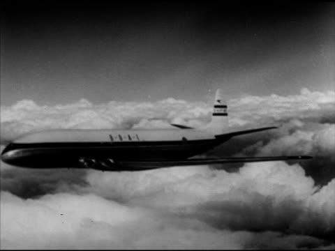 de havilland comet dashboard. aerial: de havilland comet jet in flight, over wing, navigator w/ charts, smiths marconi bearing' gauge. vs jet in... - 彗星点の映像素材/bロール