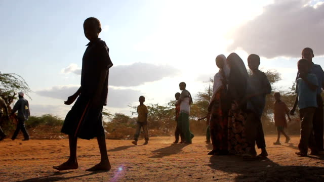 next to refugee camp refugees on august 02 2011 in road from garisa to dadaab kenya - kenia stock-videos und b-roll-filmmaterial