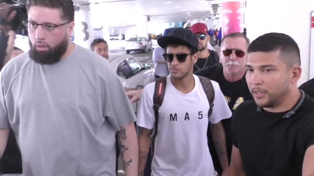 neymar get mobbed while arriving at lax airport in los angeles in celebrity sightings in los angeles - neymar da silva stock-videos und b-roll-filmmaterial