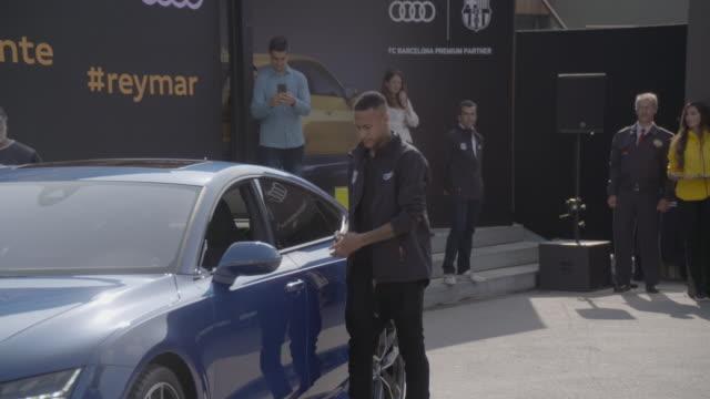 neymar jr receives a new audi 2017 car at camp nou on october 27 2016 in barcelona spain the barcelona football club first team receive new audi 2017... - neymar da silva stock-videos und b-roll-filmmaterial