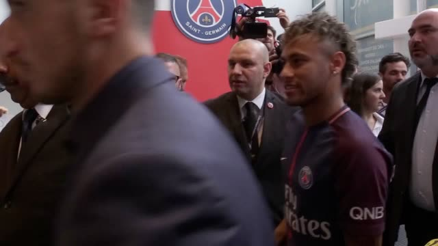 neymar walks through the crowds greeting his fans on the pitch and taking photos at le parc des princes as he is unveiled as a paris st germain player - neymar da silva stock-videos und b-roll-filmmaterial