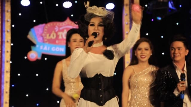 nha vy is one of hundreds of lgbt performers in vietnam who have found confidence and a way to earn a living through lotto shows a form of... - south vietnam stock videos & royalty-free footage