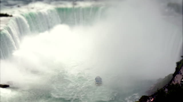 niagara cruise boat maid in the mist entering horseshoe falls in time-lapse tilt-shift miniature toy look -  med wide view from above. - river niagara stock videos & royalty-free footage