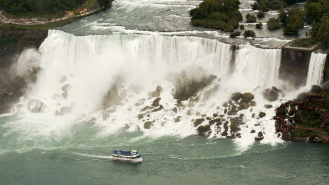 niagara cruise boat maid of the mist passing american falls and  bridal veil falls -view  from above - river niagara stock videos & royalty-free footage