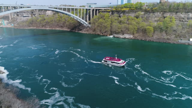 niagara falls, aerial view of the famous tourist attraction - natural landmark stock videos & royalty-free footage
