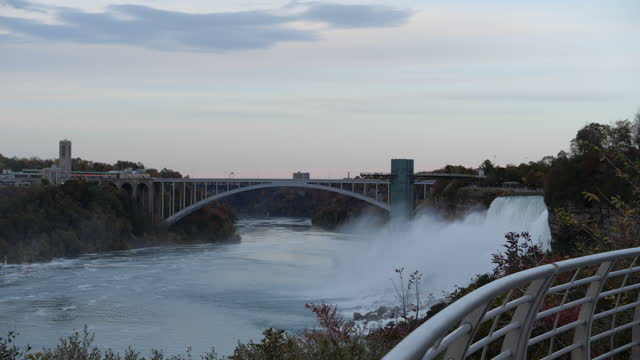 niagara falls and bridge in autumn - river niagara stock videos & royalty-free footage