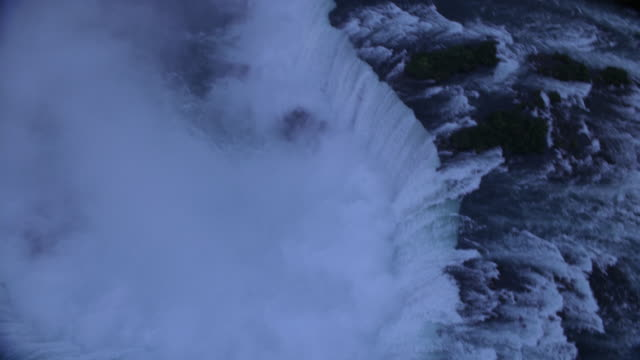 aerial, niagara falls and cityscape at dusk, ontario, canada - naturwunder stock-videos und b-roll-filmmaterial