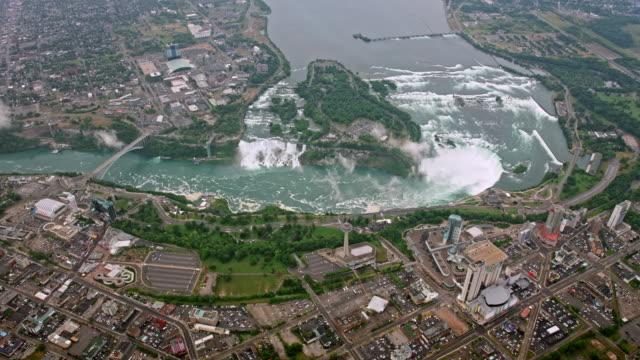 aerial niagara falls and the city of niagara, ontario right below - river niagara stock videos & royalty-free footage