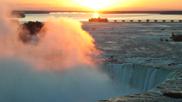 niagara falls at sunrise uhd 4k video - niagara falls stock videos and b-roll footage