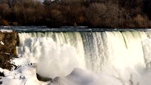 niagara falls covered with snow and ice - niagara falls stock videos and b-roll footage