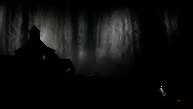 niagara falls illuminated at night  hd video - niagara falls video stock e b–roll