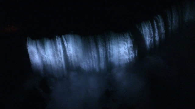 aerial, niagara falls illuminated at night, ontario, canada - naturwunder stock-videos und b-roll-filmmaterial