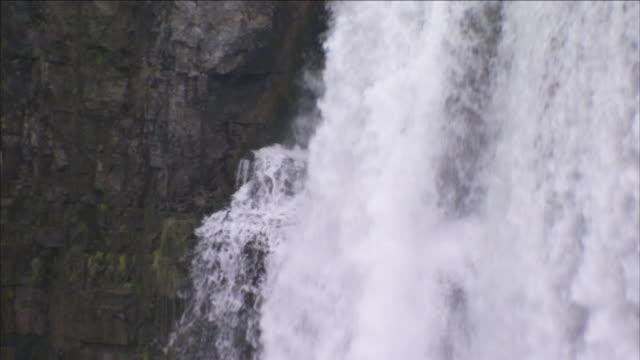 niagara falls pours over a cliff. - niagara falls stock videos & royalty-free footage