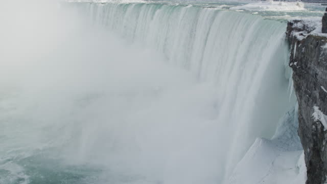 niagara falls waterfall in winter (super slow motion) - horseshoe falls niagara falls stock videos and b-roll footage