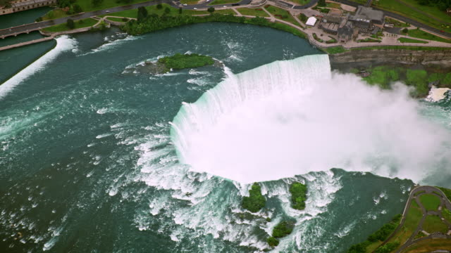 aerial niagara river flowing and creating the gorgeous horseshoe falls - famous place stock videos & royalty-free footage