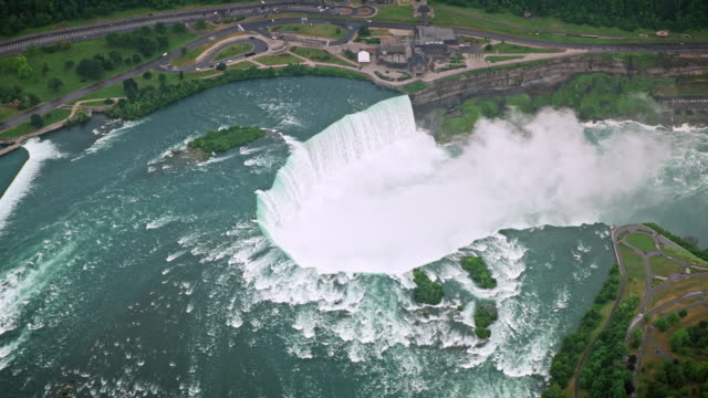 aerial niagara river flowing into the gorge and creating the famous niagara falls - river niagara stock videos & royalty-free footage