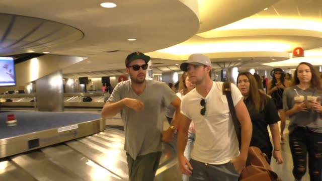 Niall Horan gets mobbed by fan girls while arriving at LAX Airport Celebrity Sightings on August 2 2016 in Los Angeles California