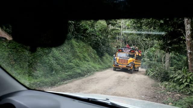 nicaragua, pantasma, bus overloaded along the road from jinoteca to pantasma - nicaragua stock videos and b-roll footage
