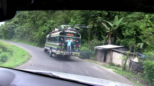 stockvideo's en b-roll-footage met nicaragua, pantasma, bus overloaded along the road from jinoteca to pantasma - nicaragua