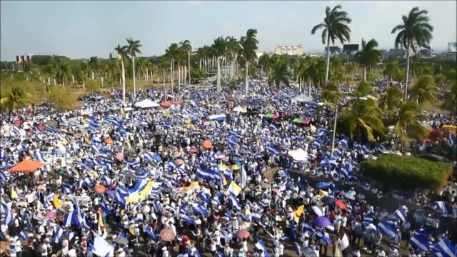nicaraguan catholic faithful take part in an open air mass to demand the end of violence in their country outside the metropolitan cathedral in... - managua stock videos & royalty-free footage