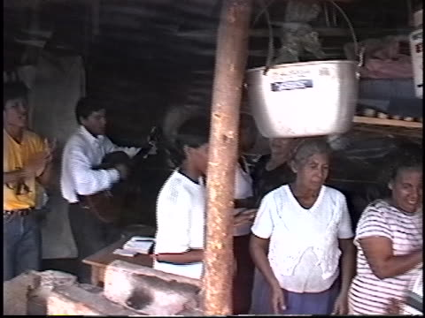 nicaraguans displaced by hurricane mitch in 1998 hold a church gathering in a shanty town outside posoltega. nicaragua is one of the poorest... - マナグア点の映像素材/bロール