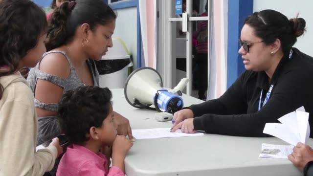nicaraguans fill out refugee requests forms at migration office in san jose costa rica - san jose costa rica stock videos & royalty-free footage